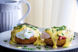 Eggs Benedict- toasted muffins, ham, poached eggs, and delicious