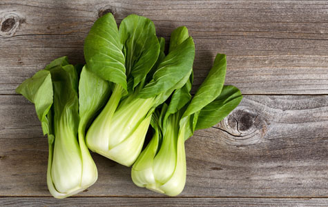 Fresh Chinese Cabbage on Rustic Wood